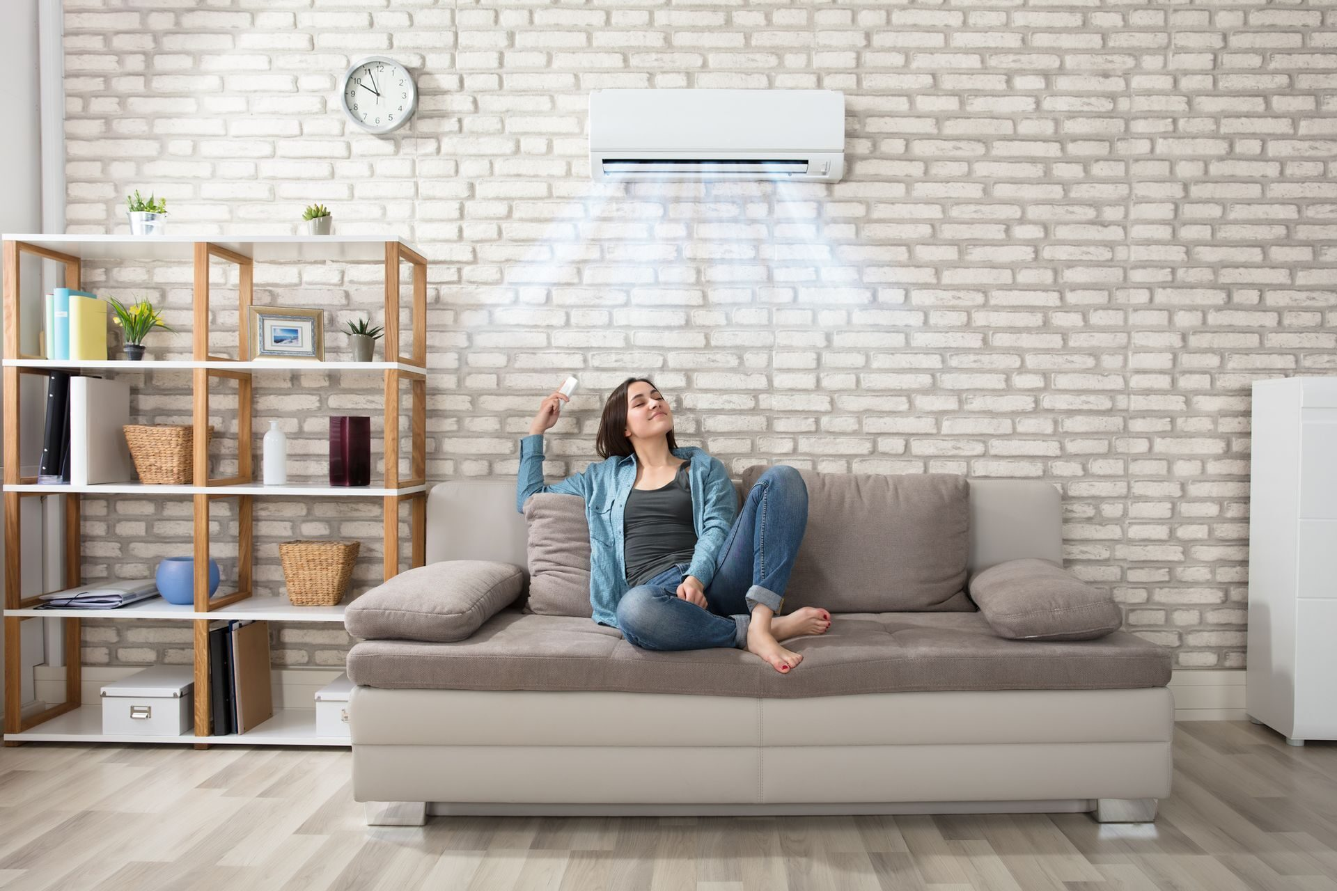 Woman Relaxing Under Air Conditioner